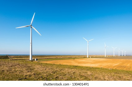Colorful landscape with a row of modern wind turbines in the Netherlands.