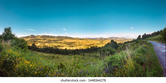 Colorful landscape valley with mountains in the background - Shutterstock ID 1448364278