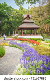 Colorful landscape view of flower garden and northern Thai's style wooden pavilion at Bhubing palace, Chiang Mai, Thailand.