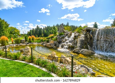 Colorful landscaping at a public waterfall and pond near the McEuen Park area of the resort mountain town of Coeur d'Alene, Idaho, USA