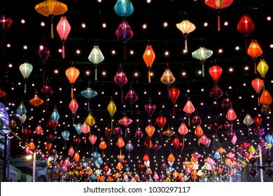 Colorful of lantern and light blub decorate in thai street food blurred background of light in New Year Chinese celebration festival.Vintage nigh flim grain Style.