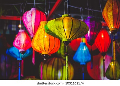 Colorful of lantern and light blub in thai street food blurred background of light in New Year Chinese celebration festival.Vintage nigh flim grain Style.