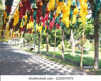 Colorful lantern are moving along the wind.Walkway in the garden