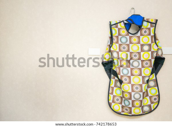 colorful lead apron and blue thyroid shield used for protection from x-ray machines.