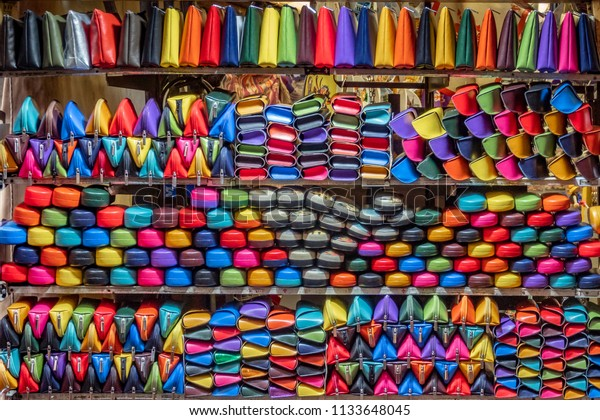 Colorful leather purses, handbags, wallets and handbags are displayed by street vendors at the outdoor Lorenzo Market, in Florence, Italy.