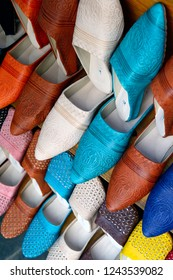 Colorful leather slippers on display in a shop in Essaouira, Morocco