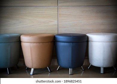 colorful leather stools in the waiting room
