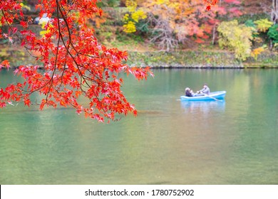 colorful leaves mountains and Katsura river in Arashiyama, landscape landmark and popular for tourists attractions in Kyoto, Japan. Fall Autumn season, Vacation,holiday and Sightseeing concept