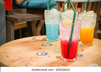 Colorful lemon soda on wooden table