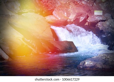 Colorful Lens Flares on a  River Rapids in the Smokey Mountains Park.