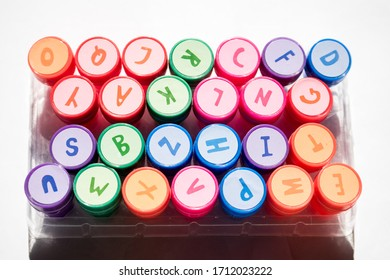 Colorful letter stamps in white background