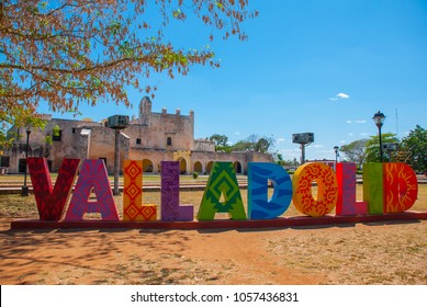 Colorful letters form the sign of Valladolid with a backdrop of Convent of San Bernardino de Siena. Valladolid, Yucatan, Mexico