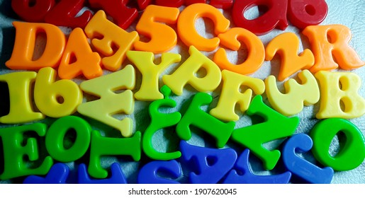 Colorful letters on background closeup. Alphabet toy