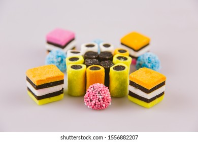 Colorful licorice candy organised in a pattern. An assortment of liquorice sweets.