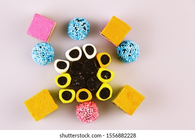 Colorful licorice candy organised in a pattern. An assortment of liquorice sweets photographed from above.