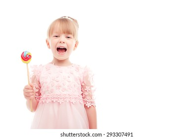 Colorful life. Nice fair-haired little girl opening her mouth and holding bright lollipop while expressing positivity