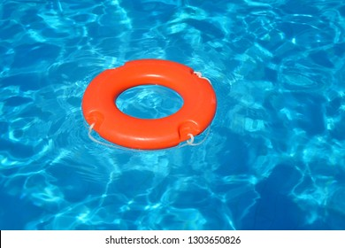 Colorful lifeguard tube floating in swimming pool, summer vacation concept