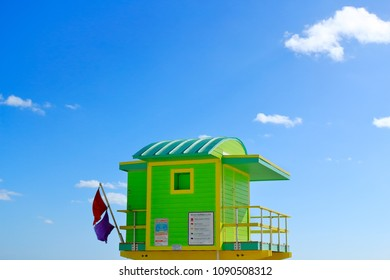 A colorful lifeguard's tower over the sky on a sunny day at Miami Beach. Sparse centered composition.