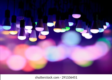 colorful light bulbs on a bokeh background