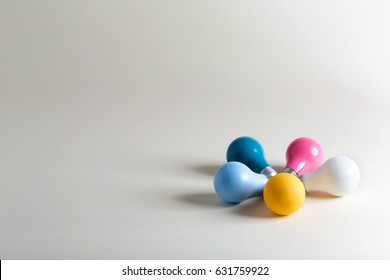 Colorful light bulbs on a white background
