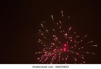 colorful light fireworks over black sky background