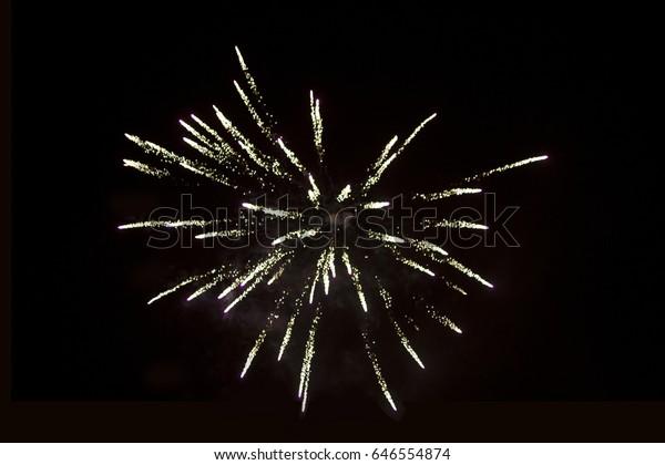 colorful light fireworks over black sky background