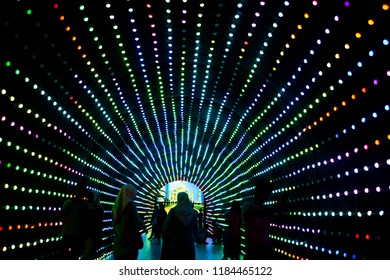 Colorful light pattern view inside tunnel with people silhouette and taj mahal poster background