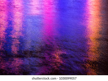 Colorful light reflection on the water. Abstract water background