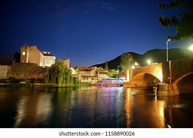 colorful light reflection of Trebinje town on Trebisnjica river at night, Bosnia And Herzegovina