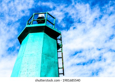 Colorful lighthouse in the dock in Santa Pola, Alicante, Spain - Shutterstock ID 1981685540