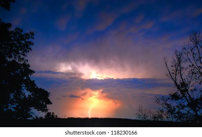 Colorful Lightning Strike on a ridge top during summer storm.