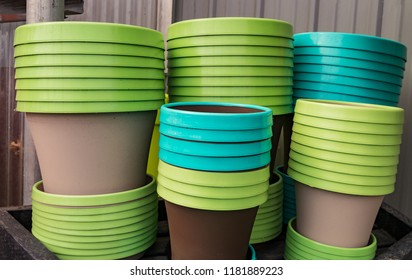 Colorful Lime Green and Turquoise Colored Flower Pots Staked together.