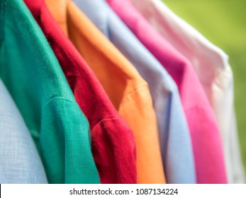 Colorful linen shirts hanging