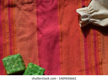 Colorful linen towel background. Concept of sustainability, simplicity. No plastic for sustainable consumption. Small green bamboo boxes and jute sack. Lots of copy space in the frame.