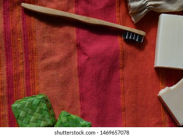 Colorful linen towel flat lay background. Concept of sustainability, simplicity. Personal hygiene items, soaps, wooden tootbrush, no plastic for sustainable consumption. Lots of copy space.
