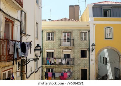 Colorful Lisbon houses with laundry on the line in Summer