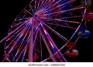 Colorful lit Ferris wheel at night