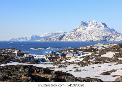 Colorful living blocks of Nuuk city at the fjord, Sermitsiaq mountain in the background, Greenland