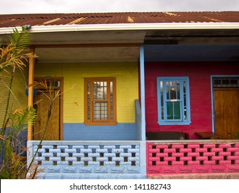 Colorful Living, Red and Yellow House with Palm Tree, San Jose, Costa Rica, Central America