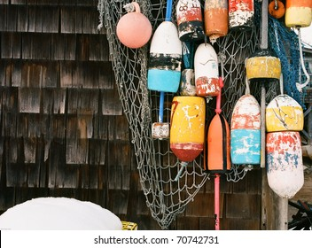 Colorful Lobster buoys and fishing nets hung outside a harbor lobster shack