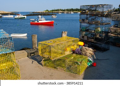 Colorful lobster traps align the dock for lobster boats moored at Matinicus Island Harbor, in Maine. This area is known for the best lobstering beds with its clear cold waters for lobsters to thrive.