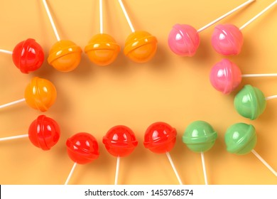 colorful lolipop on pink pastel background.sweet candy concept