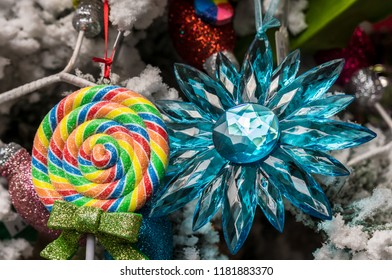 Colorful Lollipop and Crystal Blue Star Ornaments Hanging on Christmas Tree