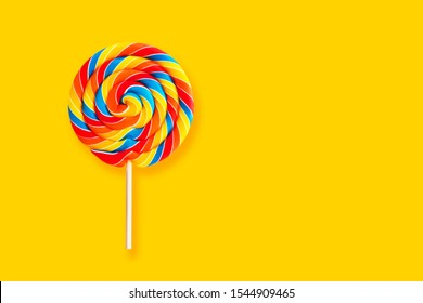 Colorful lollipop swirl on stick. Striped spiral multicolored candy