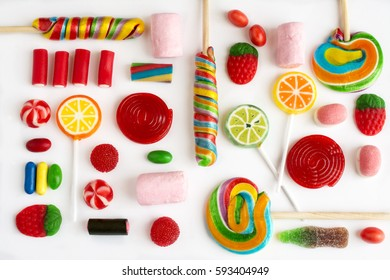 Colorful lollipops and candies and sweet candy of different colors on white background