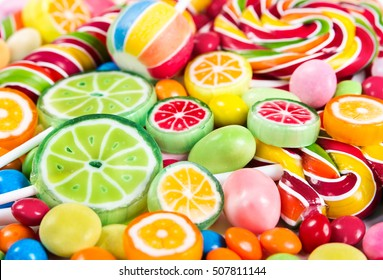 Colorful lollipops and different colored round candy