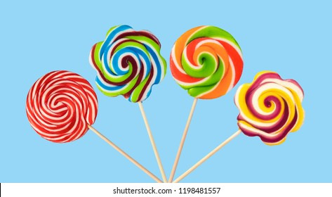 colorful lollipops isolated on blue background