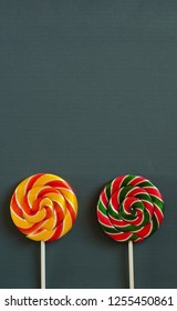 Colorful lollipops isolated on gray background.