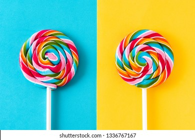 Colorful lollipops on blue and yellow background.