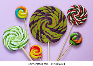 colorful lolly pop candy on a pastel background